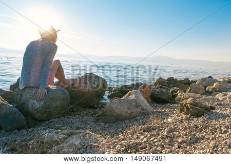 Young fashion woman relax on the beach at sunset