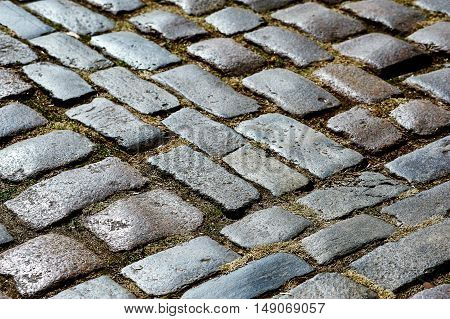 Fragment of old cobblestone road , the cobblestones