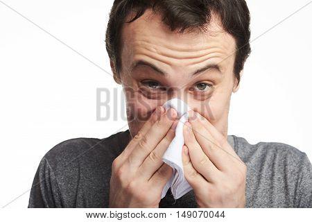 Man Blowing His Nose Hard
