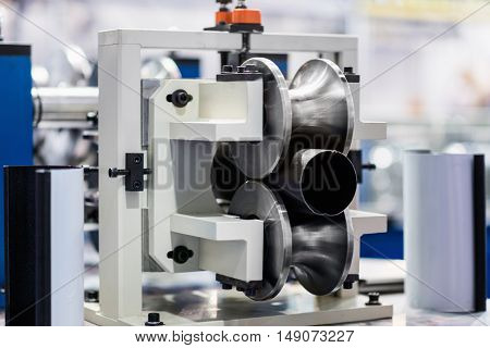 Machine for production of downspout tubes, color image, horizontal image