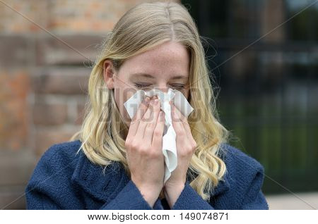 Young Woman Suffering From A Seasonal Cold