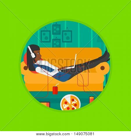 An african woman relaxing on a sofa with many gadgets. Woman surrounded by gadgets and fast food. Woman using gadgets at home. Vector flat design illustration in the circle isolated on background.