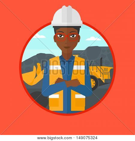 An african-american miner standing in front of a big excavator. Miner with crossed arms. Miner wearing hard hat at coal mine. Vector flat design illustration in the circle isolated on background.