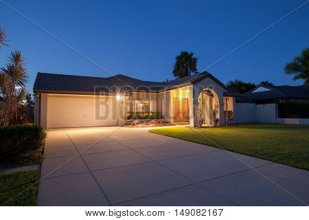 Suburban australian house front at dusk time