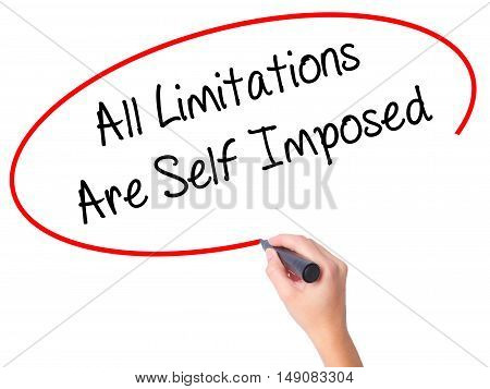 Women Hand Writing All Limitations Are Self Imposed With Black Marker On Visual Screen