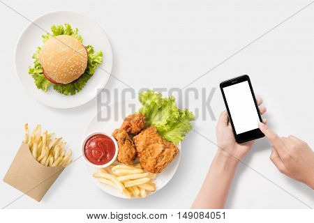Design Concept Of Mockup Using Smartphone With Burger, French Fries, Fried Chicken Set Isolated On W