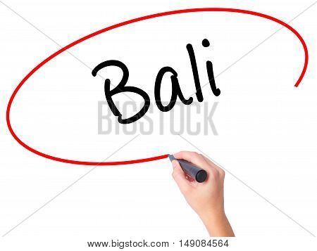 Women Hand Writing Bali  With Black Marker On Visual Screen
