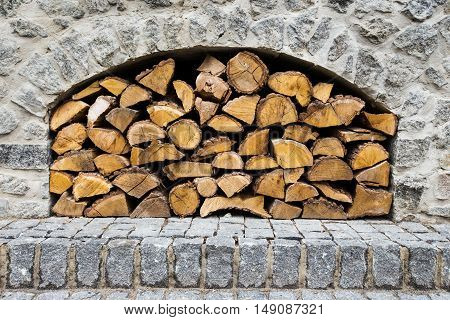stone fireplace with firewood without fire outdoors