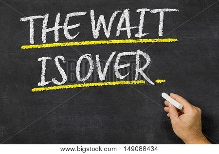The Wait Is Over Written On A Blackboard