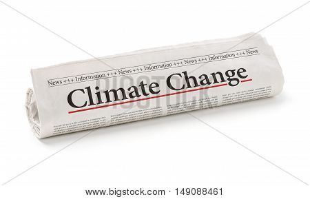 Rolled Newspaper With The Headline Climate Change
