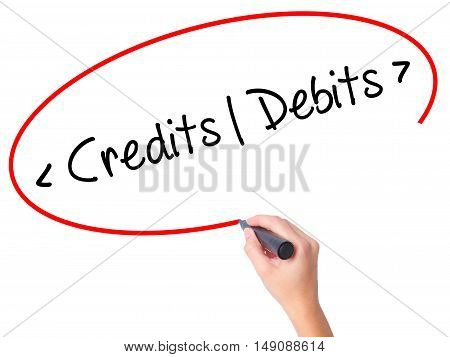 Women Hand Writing Credits - Debits With Black Marker On Visual Screen.