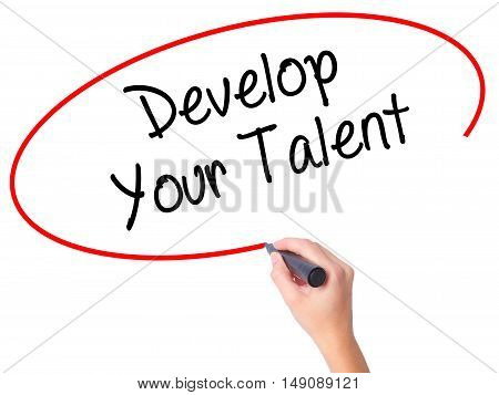 Women Hand Writing Develop Your Talent With Black Marker On Visual Screen.