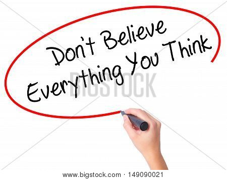 Women Hand Writing Don't Believe Everything You Think With Black Marker On Visual Screen.