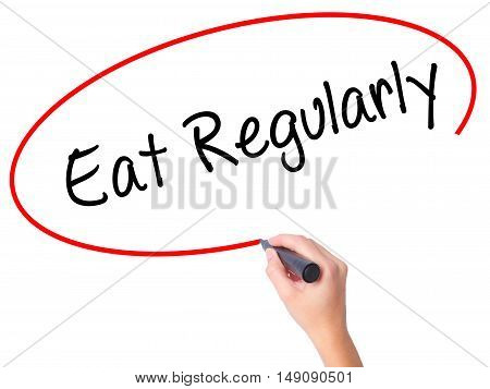 Women Hand Writing Eat Regularly With Black Marker On Visual Screen.