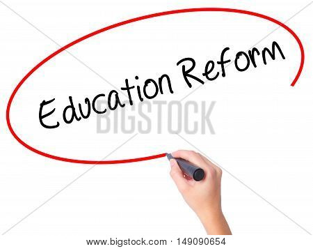 Women Hand Writing Education Reform With Black Marker On Visual Screen