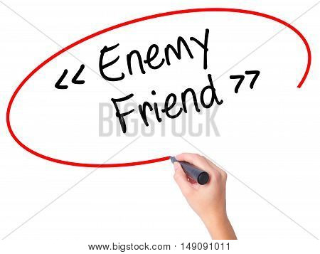 Women Hand Writing Enemy - Friend With Black Marker On Visual Screen.