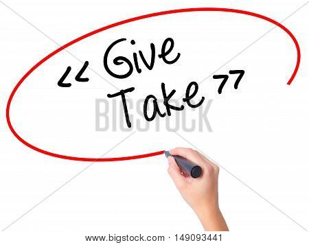 Women Hand Writing Give - Take With Black Marker On Visual Screen.
