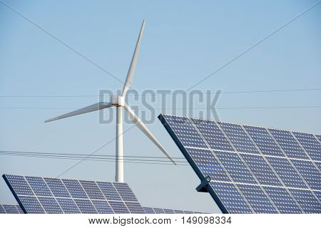 Windmills and photovoltaic panels for energy production, Navarra, Spain.