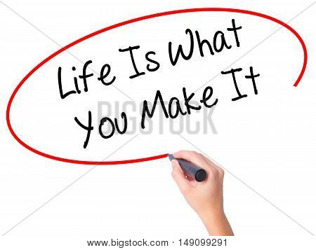 Women Hand Writing Life Is What You Make It With Black Marker On Visual Screen
