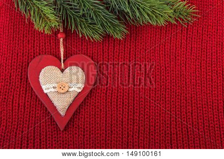 Christmas background in a farmhouse style. Red wool vintage rustic background for Christmas celebration.