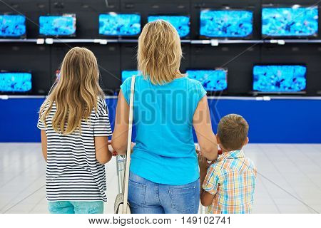 Mother With Children In Shop Of Tv