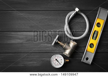 Plumber tools on a gray wooden background