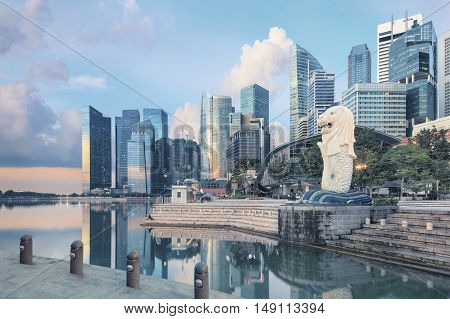 Singapore, Republic of Singapore - May 7, 2016: morning Merlion sculpture surrounded by skyscrapers