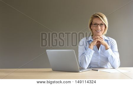 Portrait of businesswoman using laptop, isolated