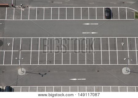 A photo of a Parking space from above.