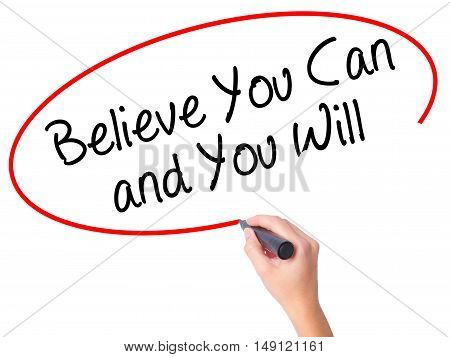 Women Hand Writing Believe You Can And You Will With Black Marker On Visual Screen