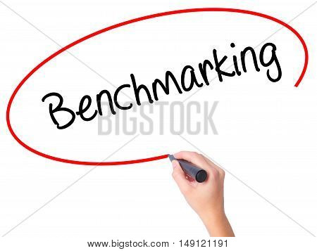 Women Hand Writing Benchmarking  With Black Marker On Visual Screen