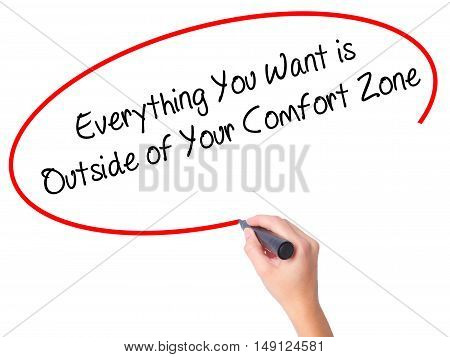 Women Hand Writing Everything You Want Is Outside Of Your Comfort Zone With Black Marker On Visual S