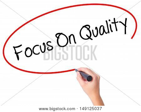 Women Hand Writing Focus On Quality With Black Marker On Visual Screen