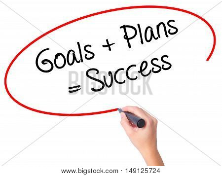 Women Hand Writing Goals + Plans = Success With Black Marker On Visual Screen.