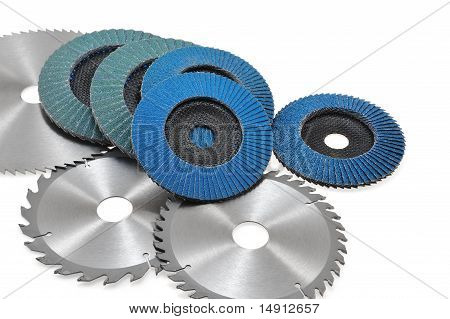 Circular saw blades and abrasive disks isolated on white