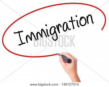 Women Hand Writing Immigration With Black Marker On Visual Screen