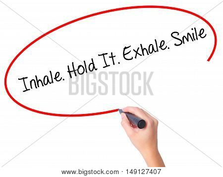 Women Hand Writing Inhale Hold It Exhale Smile With Black Marker On Visual Screen
