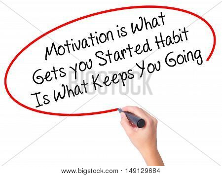 Women Hand Writing Motivation Is What Gets You Started Habit Is What Keeps You Going With Black Mark