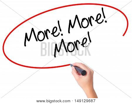 Women Hand Writing More! More! More! With Black Marker On Visual Screen
