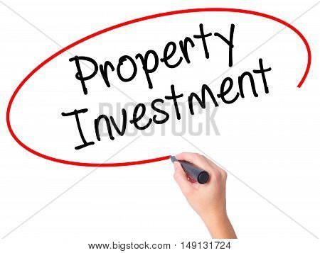 Women Hand Writing Property Investment With Black Marker On Visual Screen