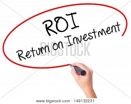 Women Hand Writing Roi  Return On Investment With Black Marker On Visual Screen