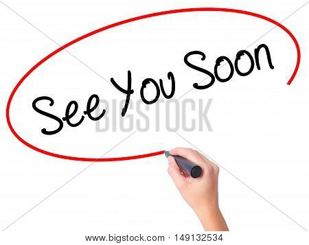 Women Hand Writing See You Soon With Black Marker On Visual Screen.