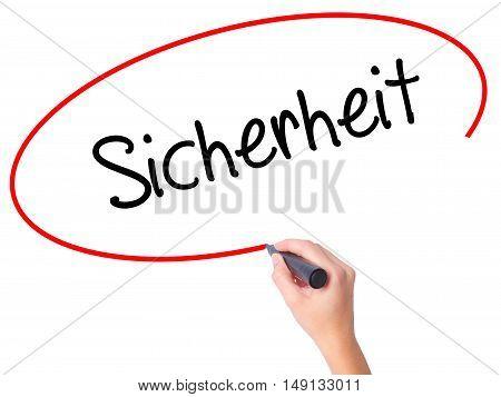 Women Hand Writing Sicherheit (safety In German) With Black Marker On Visual Screen