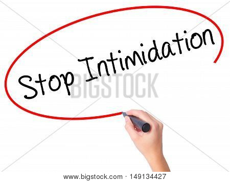 Women Hand Writing Stop Intimidation With Black Marker On Visual Screen.