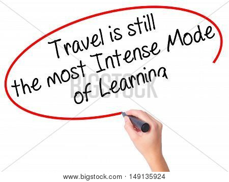 Women Hand Writing Travel Is Still The Most Intense Mode Of Learning With Black Marker On Visual Scr