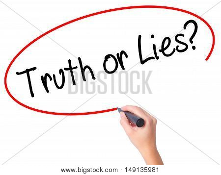 Women Hand Writing Truth Or Lies? With Black Marker On Visual Screen