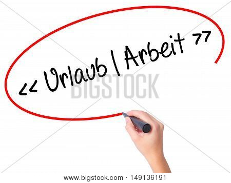 Women Hand Writing Uralaub Arbeit (vacation - Work In German) With Black Marker On Visual Screen.