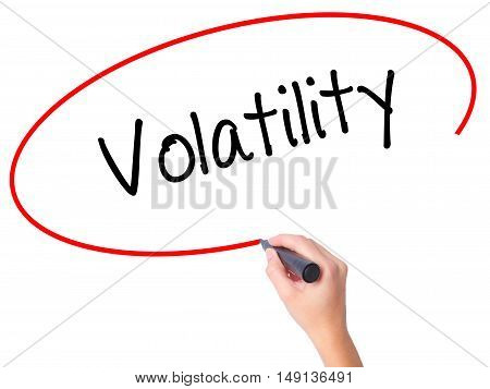 Women Hand Writing Volatility With Black Marker On Visual Screen