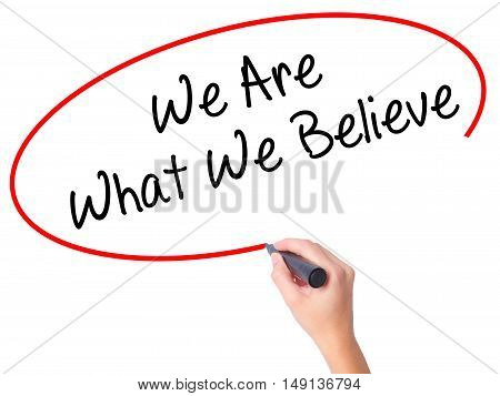 Women Hand Writing We Are What We Believe With Black Marker On Visual Screen