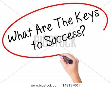 Women Hand Writing What Are The Keys To Success? With Black Marker On Visual Screen